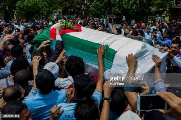 Palestinian lecture Fadi al-Batsh's body and hundreds of people arrives the Surau Medan Idaman mosque to see in Kuala Lumpur on April 25, 2018. Fadi...