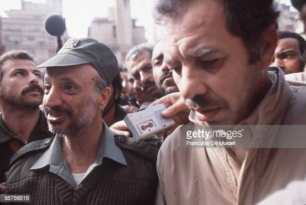 Palestinian Liberation Organization leader and later President of the Palestinian Authority Yasser Arafat and PLO spokesman Ahmed Abdel Rahman walk...