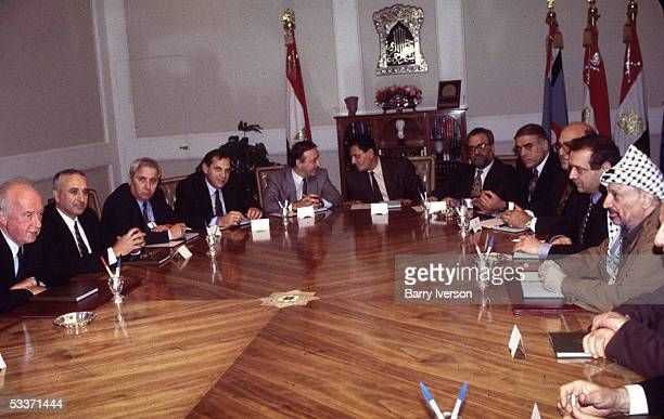 Palestinian Liberation Organization leader Yasser Arafat meeting with Israeli PM Yitzhak Rabin in Egypt re removal of Israeli troops from occupied...