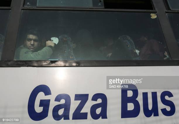 Palestinian looks out of the window of a bus as travellers arrive at the Rafah border crossing in the southern Gaza Strip to cross into Egypt, after...