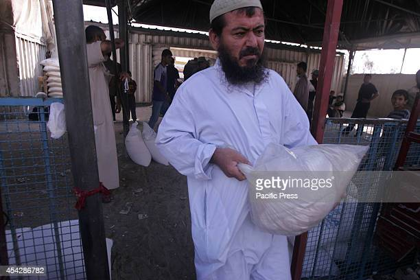 Palestinian man carrying a sack of food aid from the UNRWA after the war ended officially in Rafah Southern Gaza strip