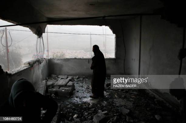 Palestinian man checks the house of man accused of the fatal September stabbing of an IsraeliAmerican after it was partially demolished by Israeli...
