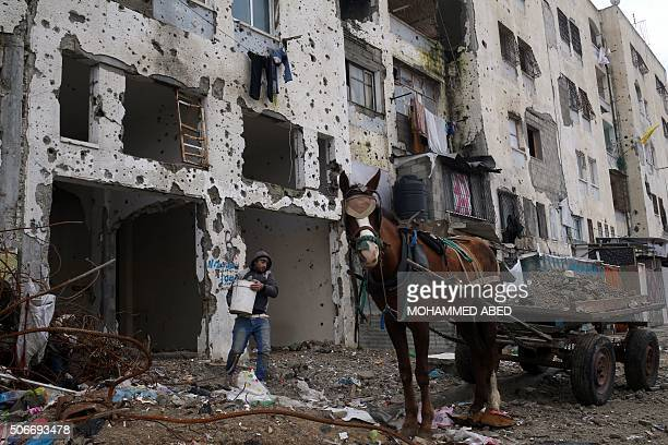 Palestinian man collects rocks from a building that was destroyed during the 50day war between Israel and Hamasled militants in January 2015 during a...