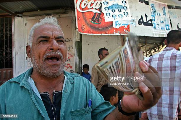 Palestinian man exchanges Egyptian currency in Rafah on the border between the Gaza Strip and Egypt 13 September 2005 The Rafah border point where...