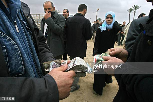 A Palestinian man exchanges New Israeli Shekels with Egyptian Pounds in Rafah on the border between the Gaza Strip and Egypt 23 January 2008...