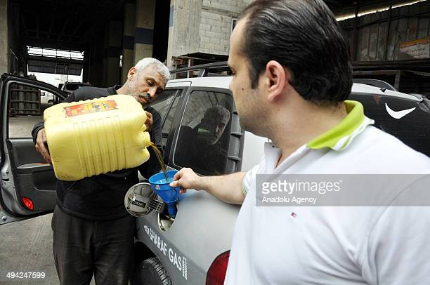 Palestinian man fills biodiesel fuel to his car which is producted from herbal oils in Gaza city Gaza on May 29 2014 Gaza has suffered under a...