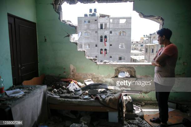 Palestinian man inspect the damage at his room after israeli airstrikes on his neighborhood in Jabalia refugee camp, North Gaza strip on May 20, 2021.