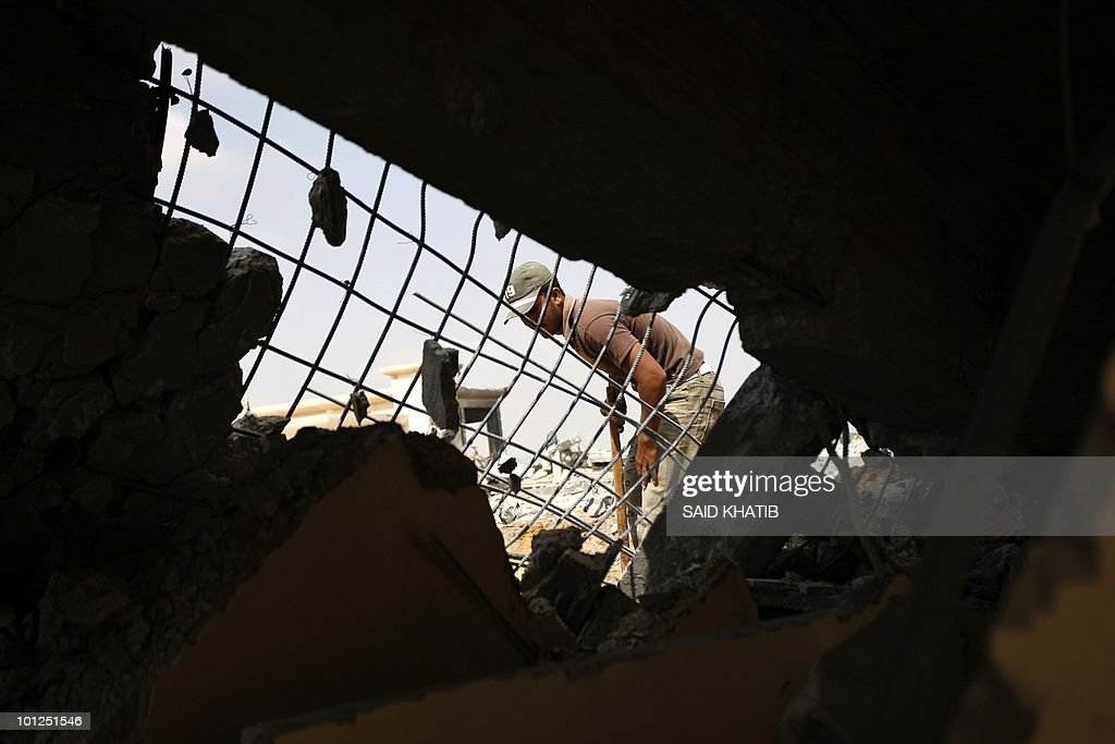 A Palestinian man inspects damages following overnight Israeli air strikes in the southern Gaza Strip town of Rafah on May 29, 2010. Israeli warplanes launched six overnight raids, Palestinian security officials and witnesses said, adding that nobody was wounded.