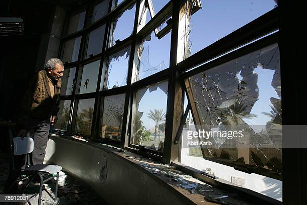 Palestinian man inspects the art class room of an American school after it was destroyed by unknown gunmen on January 12 2008 in Beit Lahia northern...