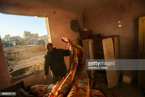 Palestinian man inspects the damage at his house on December 9 in the aftermath of an Israeli air strike in Beit Lahia in the northern Gaza Strip...