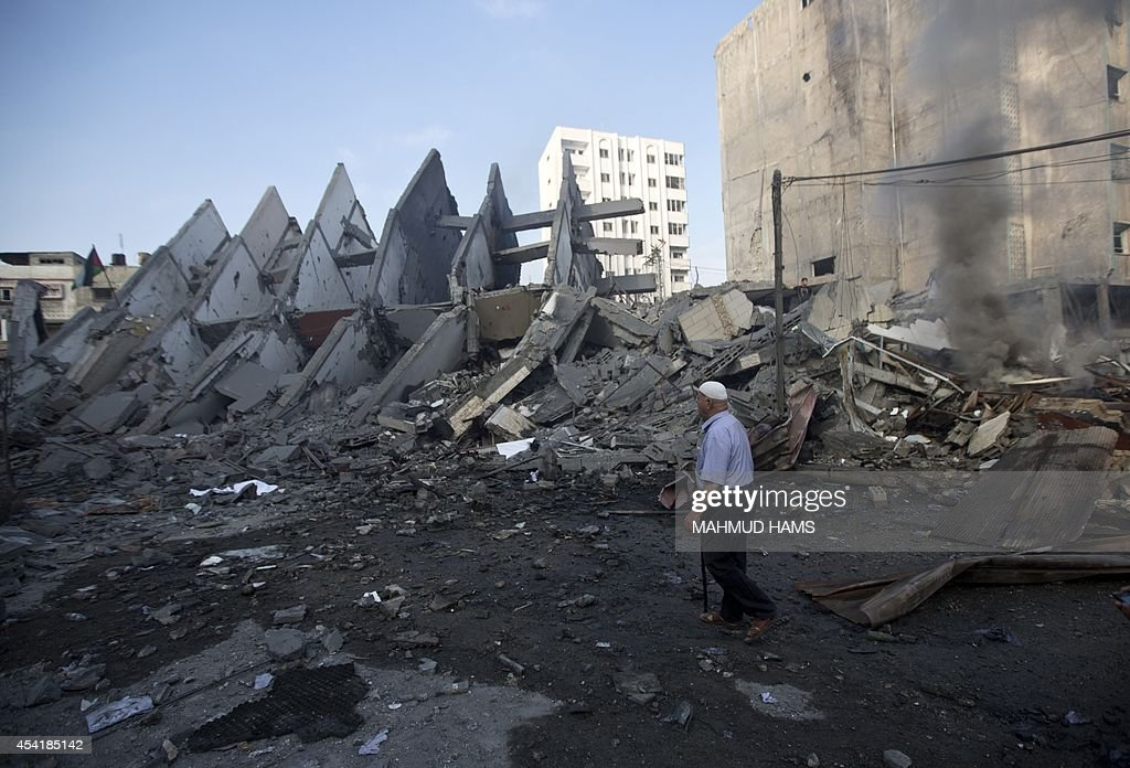 A Palestinian man inspects the remains of a building that was destroyed by an Israeli air strike in Gaza City on August 26, 2014, killing two Palestinians, as Israel pursued its campaign to stop rocket fire by Hamas militants from the enclave, medics said. Egypt has proposed a new ceasefire in the Gaza conflict that would open key border crossings into the battered Palestinian territory, after Israeli raids killed at least 10 more Palestinians.