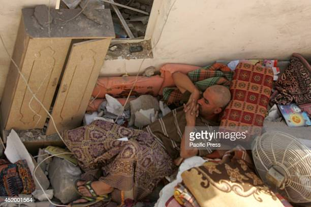 Palestinian man laying on the rubble of his house which was hit by an Israeli airstrike killing eight people in the southern Gaza Strip city of Khan...