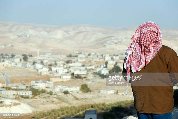 palestinian man looking at west bank landscape from the herodian - palestinian stock photos and pictures