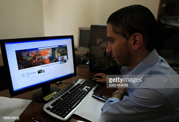 A Palestinian man looks at the Facebook page of Avichay Adraee the spokesman of the Israeli Army to the Arabic media after hackers replaced his cover...
