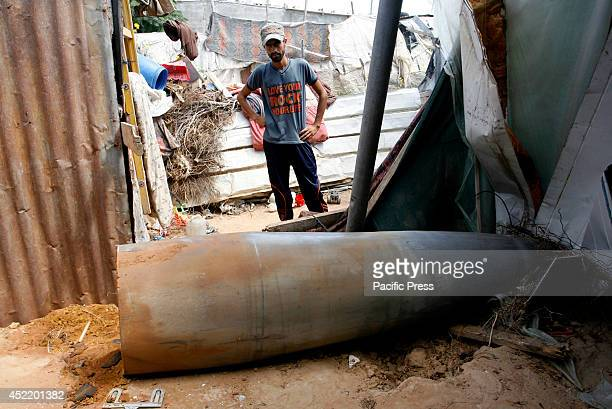 Palestinian man looks at the rocket hit by Zionist warplanes that did not explode in the home of citizens east of Rafah in southern Gaza Strip. The...