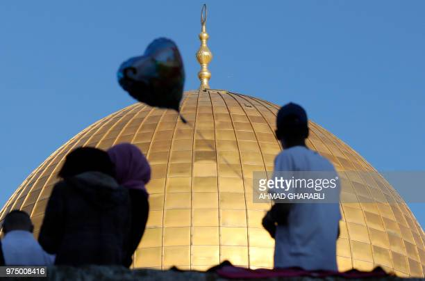 A Palestinian man looks prior to the morning Eid alFitr prayer at the Dome of Rock at the AlAqsa Mosque compound Islam's third most holy site in the...