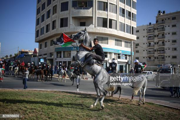 Palestinian man on a horse holds a Palestinian flag during a demonstration organized by Palestine Equestrian Federation to show solidarity with...