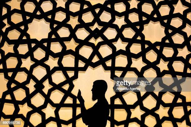 Palestinian man performs prayer at Great Mosque of Gaza during the holy month of Ramadan in Gaza City Gaza on May 31 2017