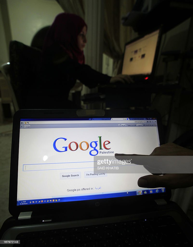 A Palestinian man points at the word 'Palestine' on the Palestinian homepage of Google's search engine in Rafah in the southern Gaza Strip on May 3, 2013. Internet giant Google has recognised the Palestinians' upgraded UN status, placing the name 'Palestine' on its search engine instead of 'Palestinian Territories,' the US company said, raising the ire of Israel.