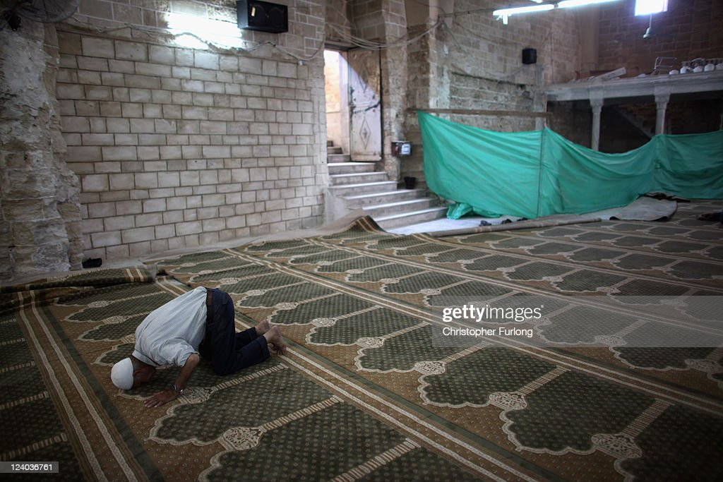 A Palestinian man prays in the Al-Omari Mosque on August 18, 2011 in Gaza City, Gaza. Palestinian President Mahmoud Abbas will formally submit the application for Palestinian statehood to the 66th United Nations General Assembly in New York on September 20th. The Palestinians and the Israelis are taking part in global diplomatic lobbying to win support for their differing positions on statehood. The Palestinian bid arises from two decades of on-and-off peace talks that have failed to produce a deal. The ultimate goal of the Palestinian Authority is to end Israeli occupation and to establish a sovereign and independent state on the 1967 borders with Jerusalem as its capital.