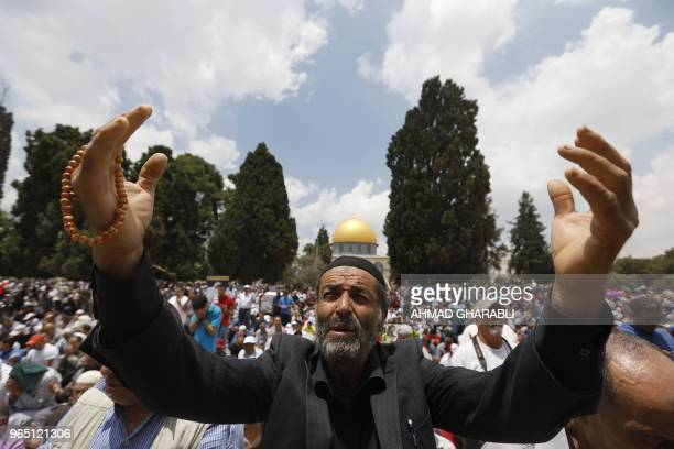 A Palestinian man prays outside the Dome of the Rock mosque in Jerusalem's AlAqsa Mosque compound on the third Friday prayers of the Muslim holy...