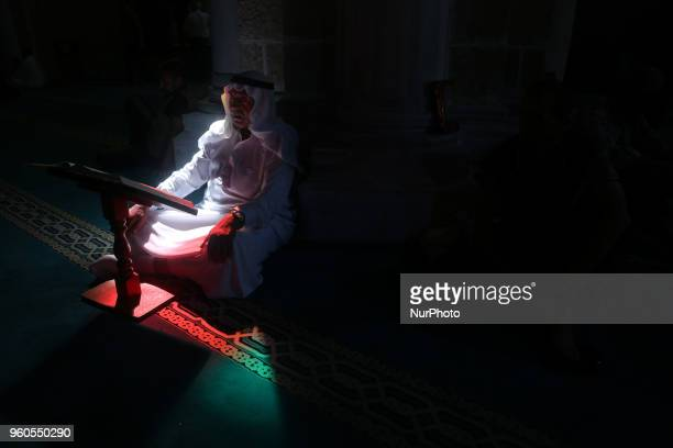 A Palestinian man reads the Koran at AlOmary Mosque in Gaza City on the fourth day of the holy month of Ramadan May 20 2018