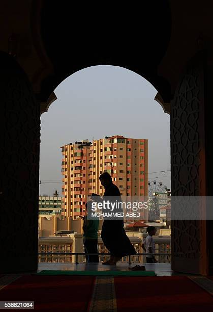A Palestinian man reads the Koran at the alKhaldi mosque in Gaza City on June 8 2016 on the third day of the Muslim holy month of Ramadan Islamic...