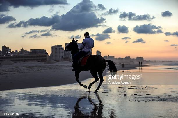Palestinian man rides his horse at the Gaza beach in Gaza City Gaza on December 31 2016