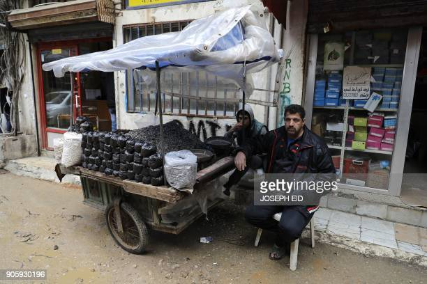 A Palestinian man sells seeds at the Burj alBarajneh camp in the Lebanese capital Beirut on January 17 2018 The UN agency for Palestinian refugees...