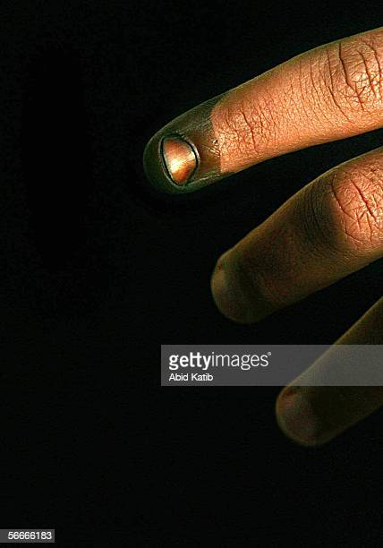Palestinian man shows his inked finger proving that he has voted at a polling station in the UN school Alef which is being used as an election...