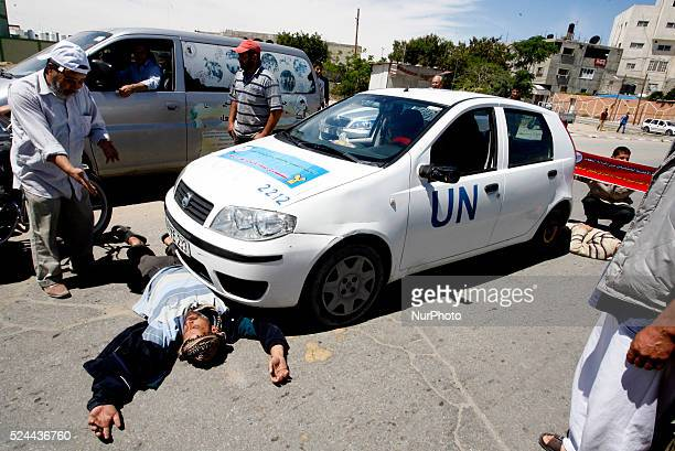 A Palestinian man sleeps in front of the United Nations car During a protest in front of the UNRWA headquarters against their decision to reduce aid...