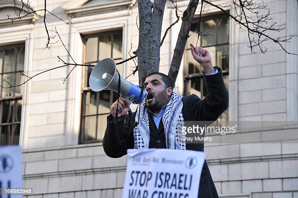 Palestinian man speaks to protesters in Dublin calling for the end of the blockade of Gaza