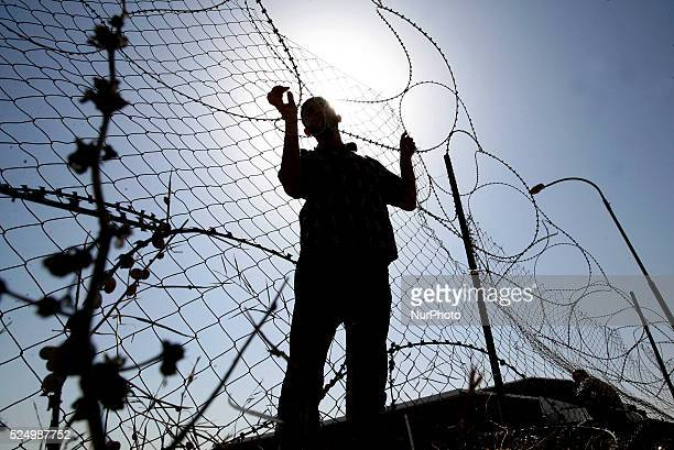 Palestinian man waits to cross into Egypt at the Rafah border crossing between Egypt and the southern Gaza Strip on June 17, 2014. Egyptian...