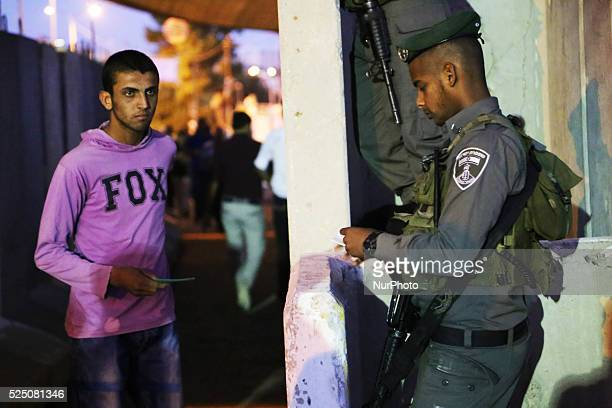 A Palestinian man walks through bethlehem checkpoint as Palestinians wait to show their identity cards to Israeli security officers to make their way...