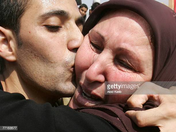 Palestinian man who was released from Israeli prison hugs his mother on October 2 2007 at the Erez Crossing between the Gaza Strip and Israel Israel...