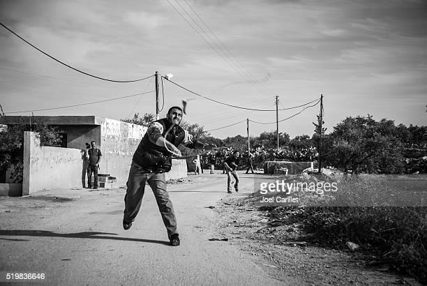 Palestinian man with slingshot in West Bank village Bil'in