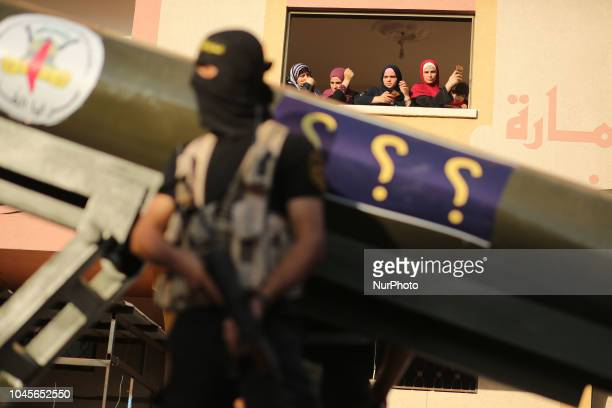 Palestinian masked members of AlQuds Brigades the military wing of the Islamic Jihad group march with their weapons to show loyalty for the...