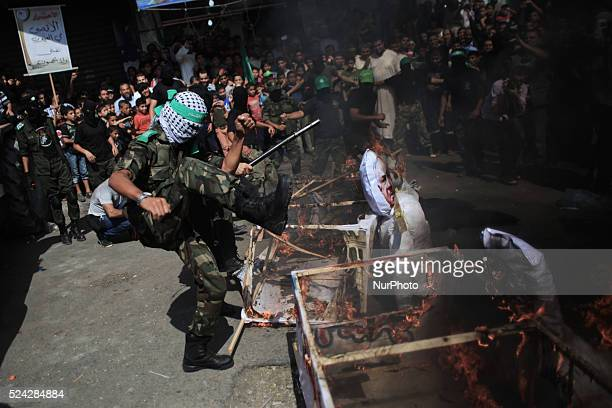 A Palestinian masked of Hamas burn models simulation for Israeli leaders during a rally marking 13th anniversary of the socalled AlAqsa uprising or...