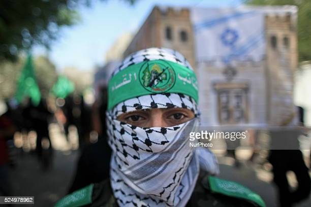 A Palestinian masked of Hamas holds a coffin for Israeli leaders during a rally marking 13th anniversary of the socalled AlAqsa uprising or 'Second...