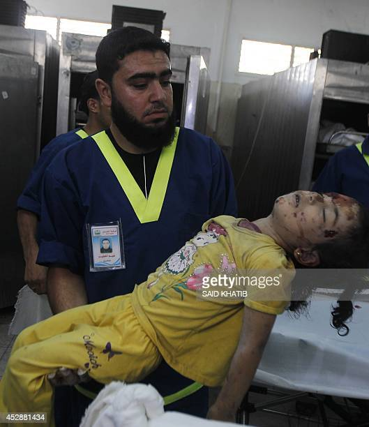Palestinian medics carries the body of Rana Duheir a Palestinian girl killed in an Israeli air strike that destroyed her family's house in Rafah in...