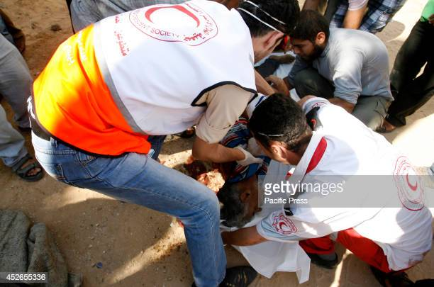Palestinian medics transport a man who was killed by an Israeli air strike in the town of Khuza'a, East of Khan Younis in the Southern Gaza Strip....
