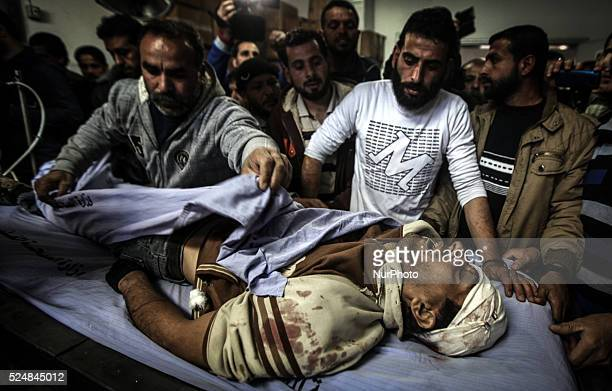 Palestinian medics wheel the body of Ibrahim Suleiman Mansour dead by Israeli security forces at a hospital in Gaza City on February 13 2014 A...