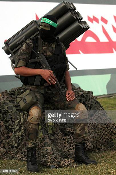 A Palestinian member of Hamas's armed wing sits on a multiple rocket launcher before an antiIsrael rally in Rafah in the southern Gaza Strip November...