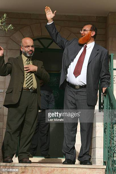 Palestinian member of parliament Ahmed Attun looks on as Mohammed Abu Tir waves to the press upon the arrival of three Arab-Israeli members of the...