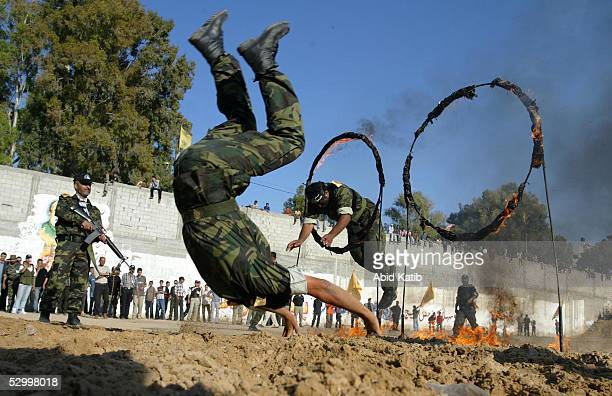 Palestinian members from the Palestinian nationalistic group Al Aqsa Martyrs Brigades, demonstrate their military skills during a rally in the Khan...