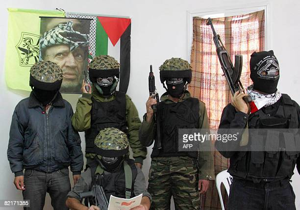 Palestinian members of AlAqsa Martyrs Brigades an armed wing loosely linked to Palestinian president Mahmud Abbas's Fatah movement hold a press...