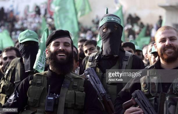Palestinian members of Hamas military wing Al-Qassam attend a Hamas 19th anniversary rally on December 15, 2006 in Gaza City, Gaza Strip. Hamas has...