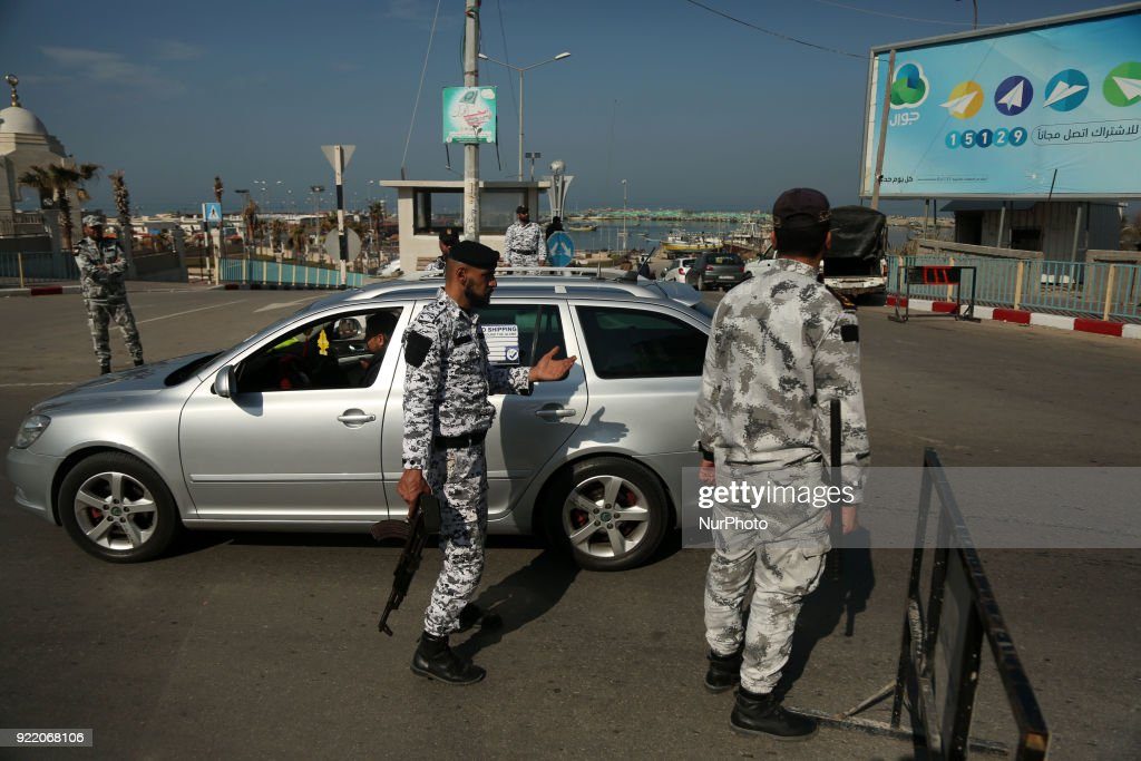 Palestinian members of Hamas security forces stop a vehicle at a security checkpoint in Gaza City on February 21, 2018.