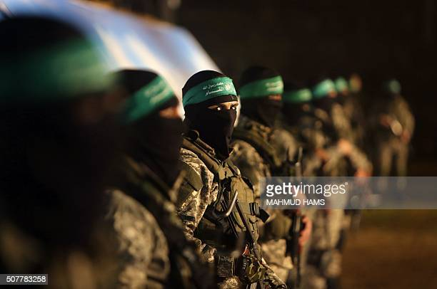 TOPSHOT Palestinian members of the Ezzedine alQassam Brigades the armed wing of the Hamas movement take part in a gathering on January 31 2016 in...