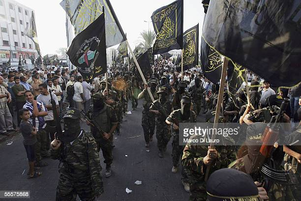 Palestinian members of the Islamic Jihad Militant Movememt parade at a rally in the Gaza City on September 15 2005 in Gaza City Gaza Hundreds of...
